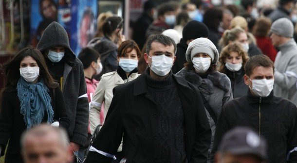 People in protective masks walk in the centre of Russia's southern city of Nazran